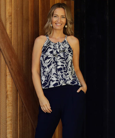 navy and white printed halter-neck summer top with shirt-tail hemline