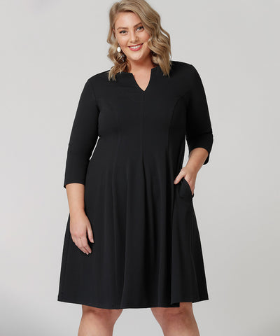 tailored dress with size pockets and 3/4 length sleeves