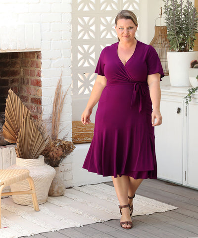 wrap dress with flutter sleeves and skirt ruffle in magenta