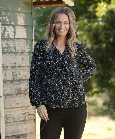 v-neck style long sleeve top with bell sleeves in black and white print