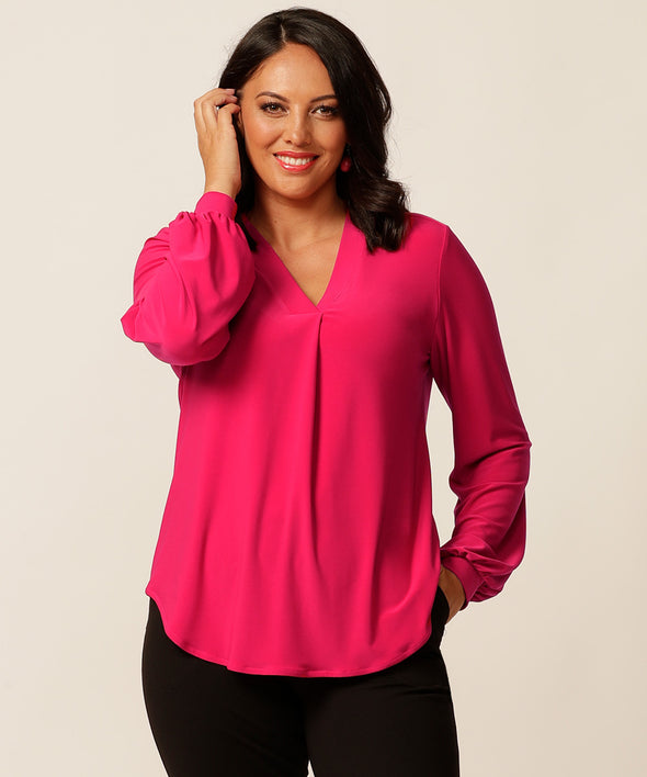 pink long sleeve office style top with a vneck detail