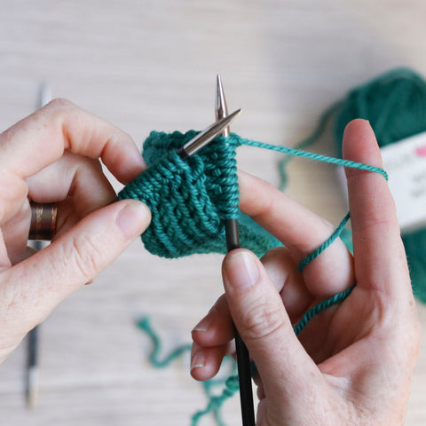 Hot Mess Headband tutorial: Twist and continue knitting to create the cable