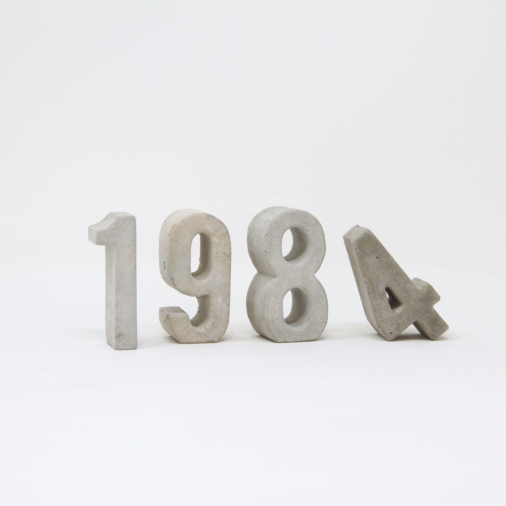 Hand-cast concrete numbers by An Artful Life.