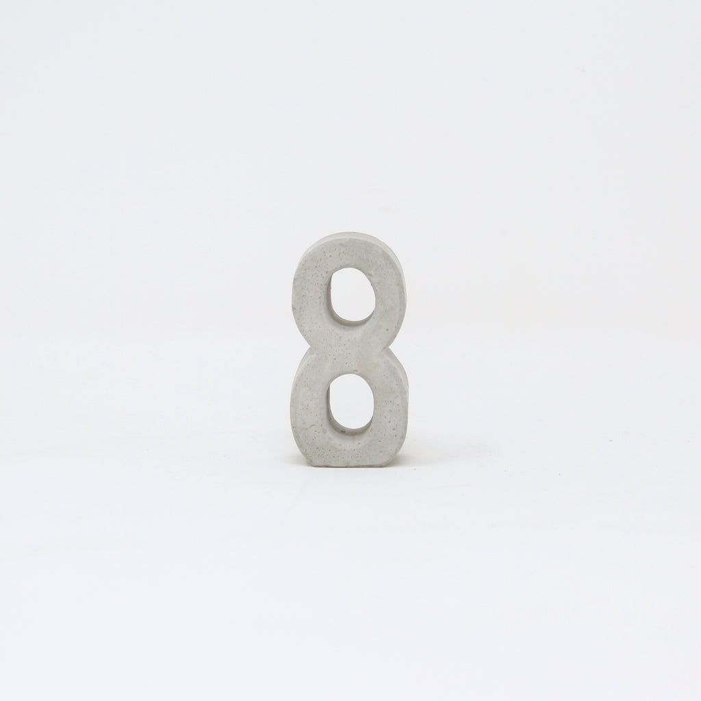 Hand-cast concrete number 8.