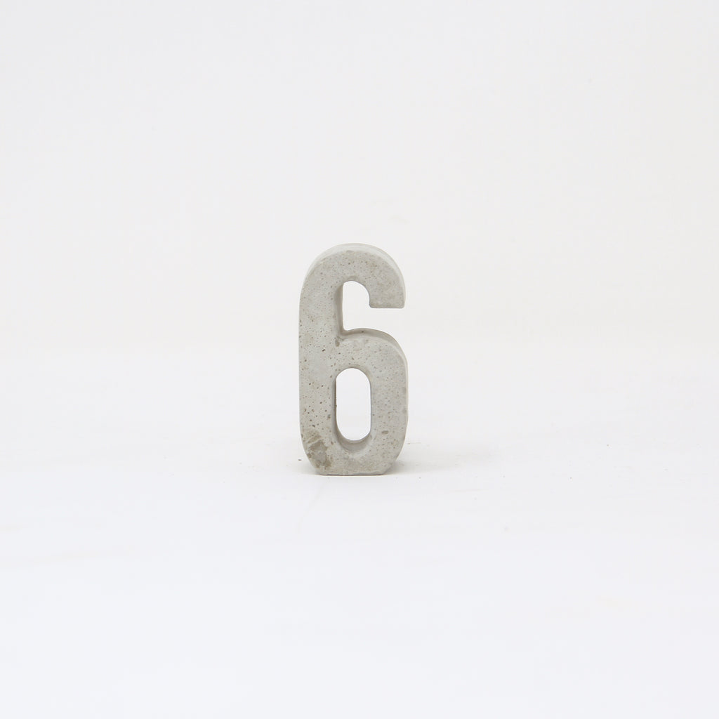 Hand-cast concrete number six.