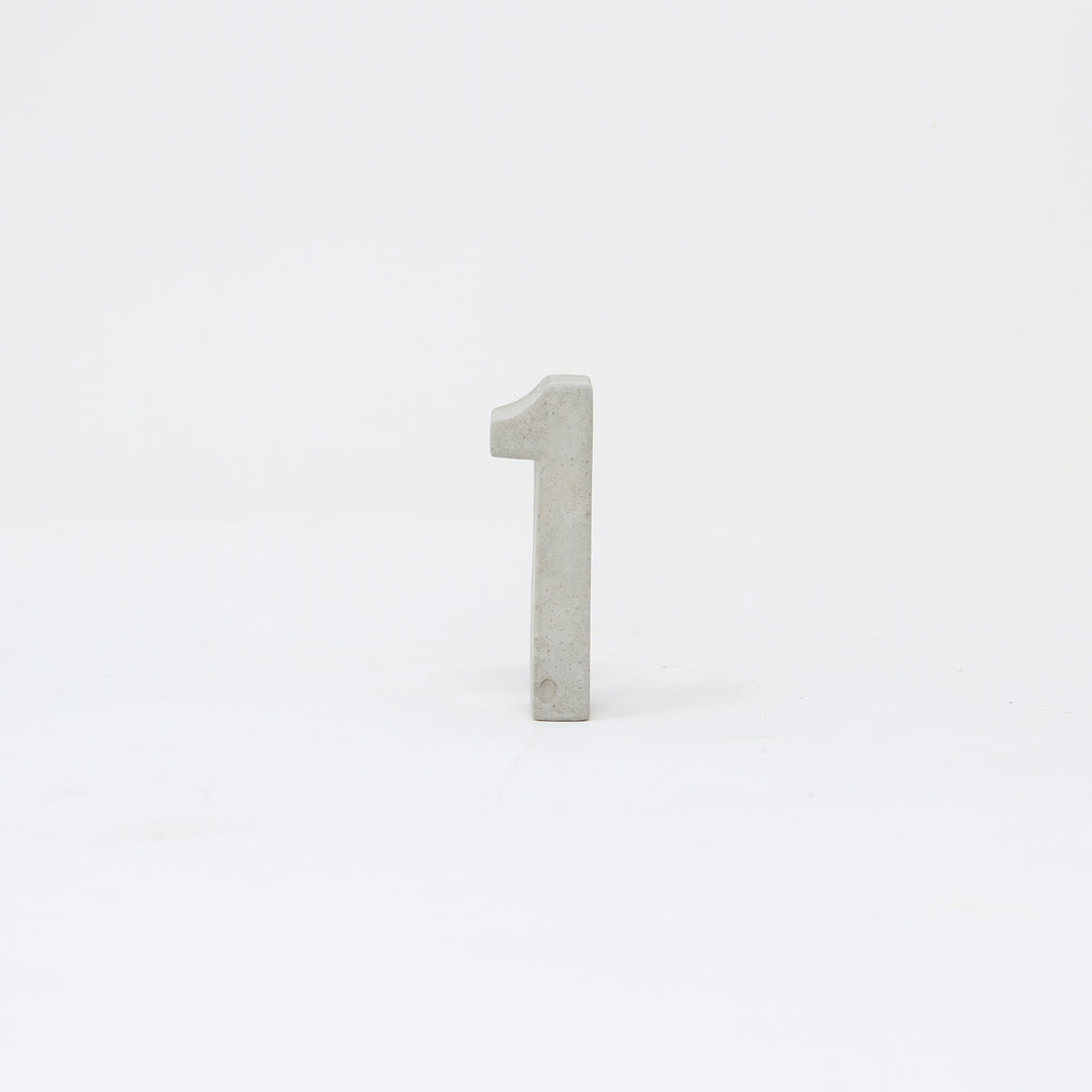 Hand-cast concrete number one.