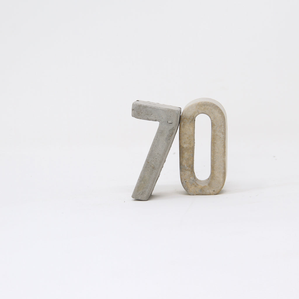 Hand-cast concrete number seven and zero.
