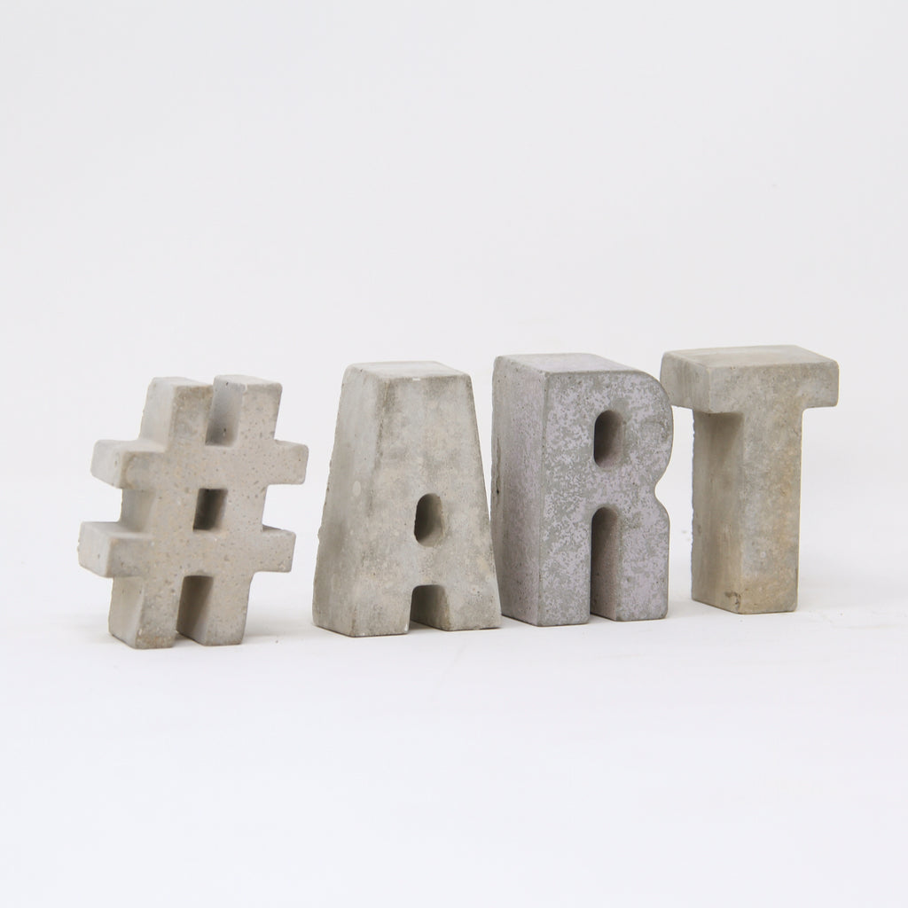 Hand-cast hashtag and concrete letters by An Artful Life.