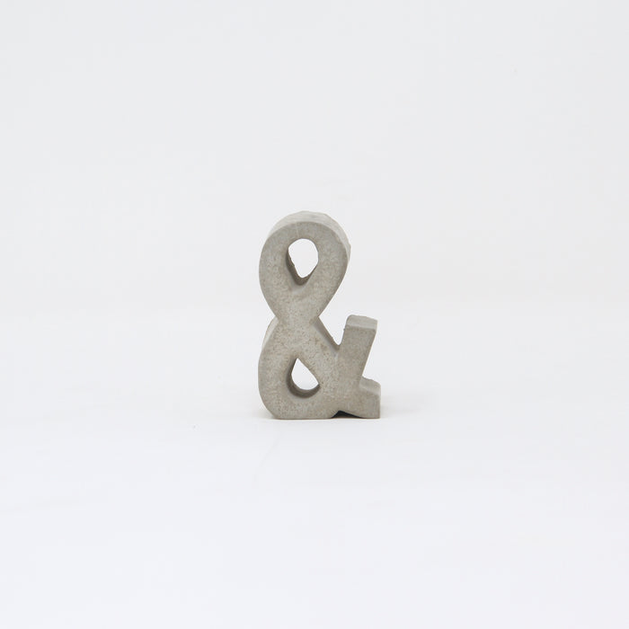 Hand-cast concrete ampersand by An Artful Life.