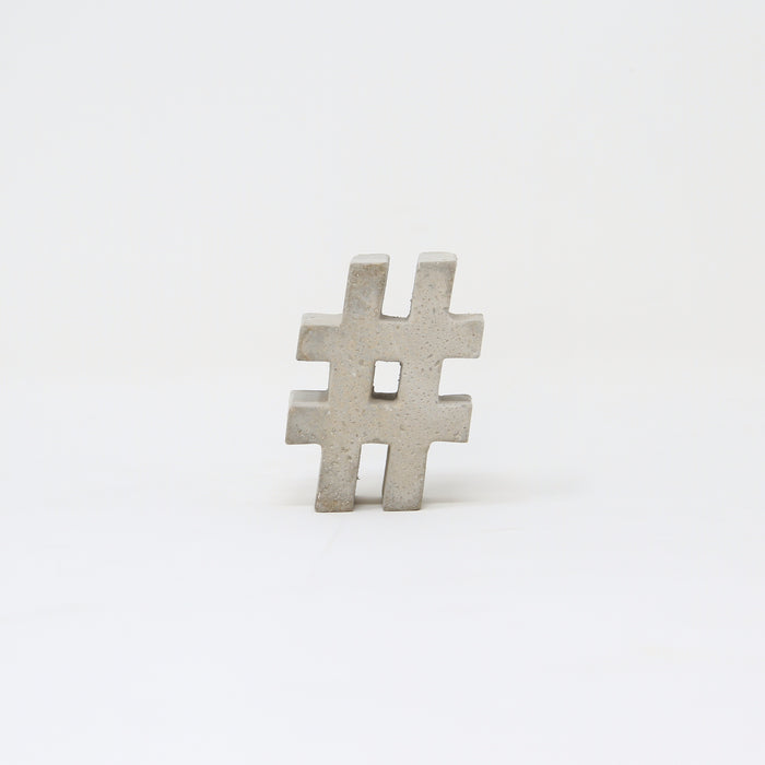 Hand-cast concrete hashtag by An Artful Life.
