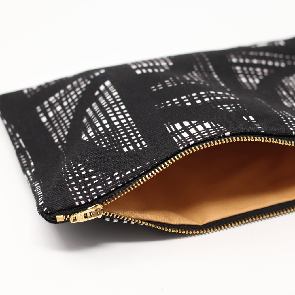 INTERIOR LINING OF BLACK LINE POUCH BY DING DING DESIGNS.