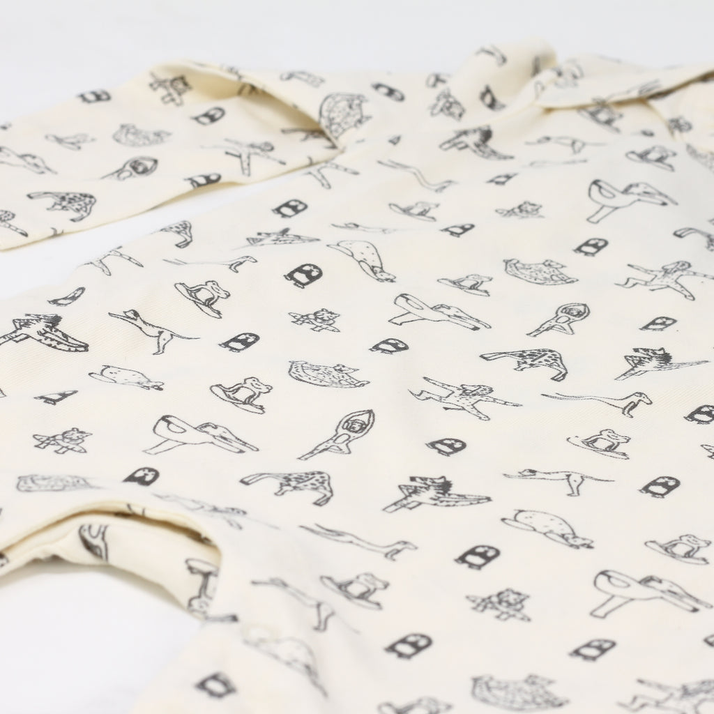 Close up shot of 'Animal Yogi' baby jumpsuit by Yoga Baby.