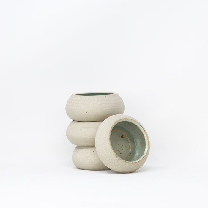 Handmade green ceramic tea-lights by Libby Ballard.