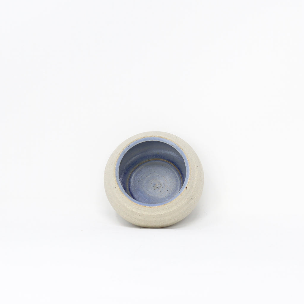 Handmade blue ceramic tea-lights by Libby Ballard.