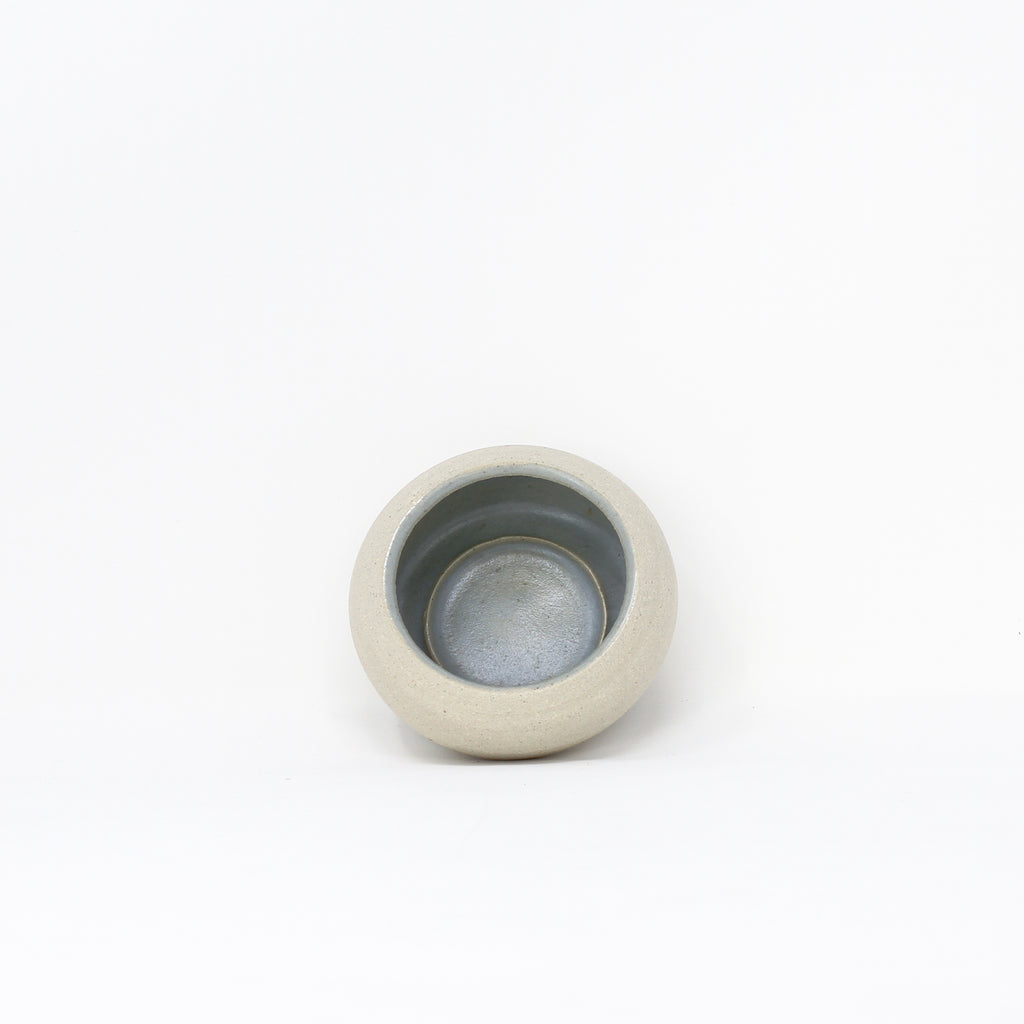 Handmade grey ceramic tea-lights by Libby Ballard.