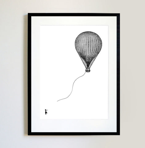 Girl with a hot air balloon Framed Print