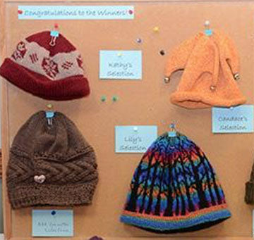 Photograph of several different types of knitted hats that are for donation.