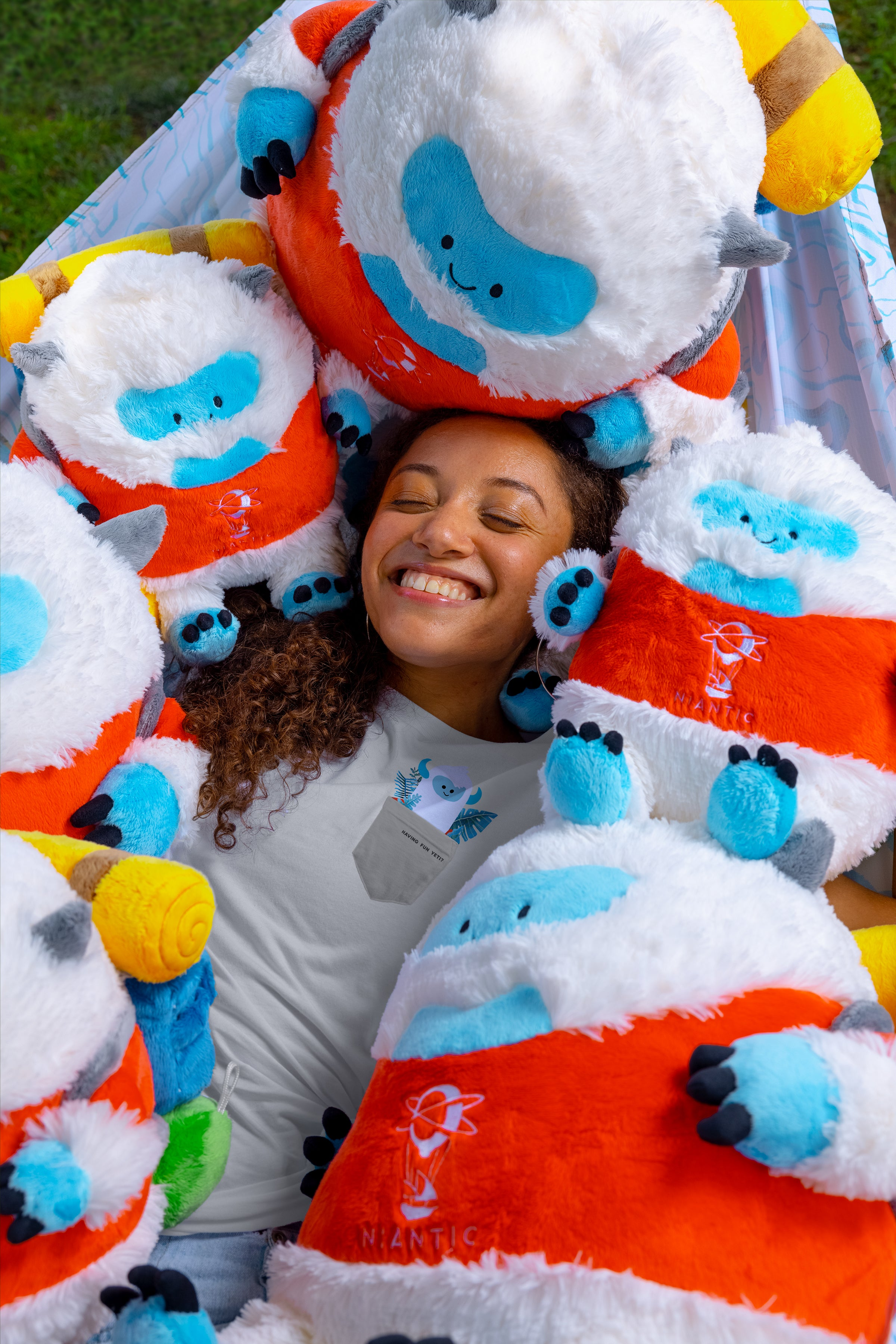 person surrounded by niantic plush yeti