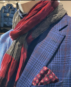 Dress scarf in grey and red on mannequin in blue suit