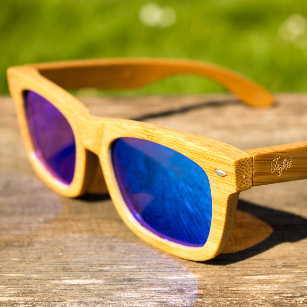 Blue Rayban Jnglst Bamboo Sunglasses on Table