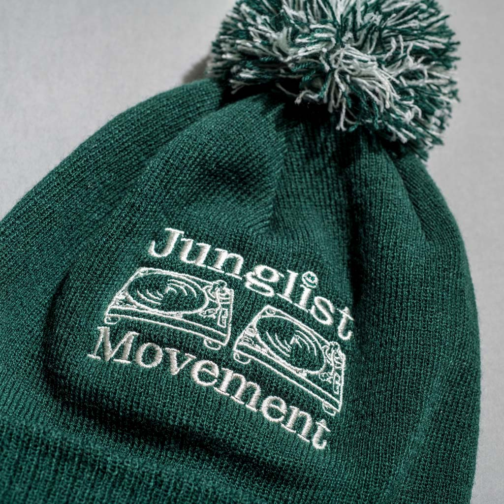 Close up of Bottle Green Junglist Movement Beanie