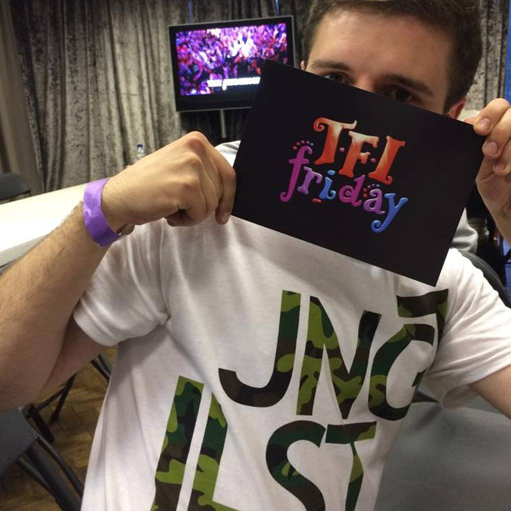 The white JNGLST Tee on TFI Friday
