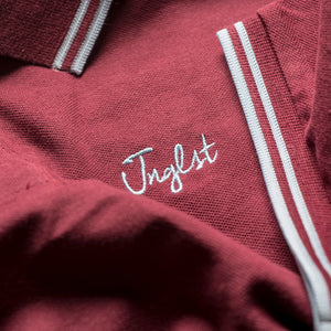 Close up of Junglist Clothing logo on Polo Shirt