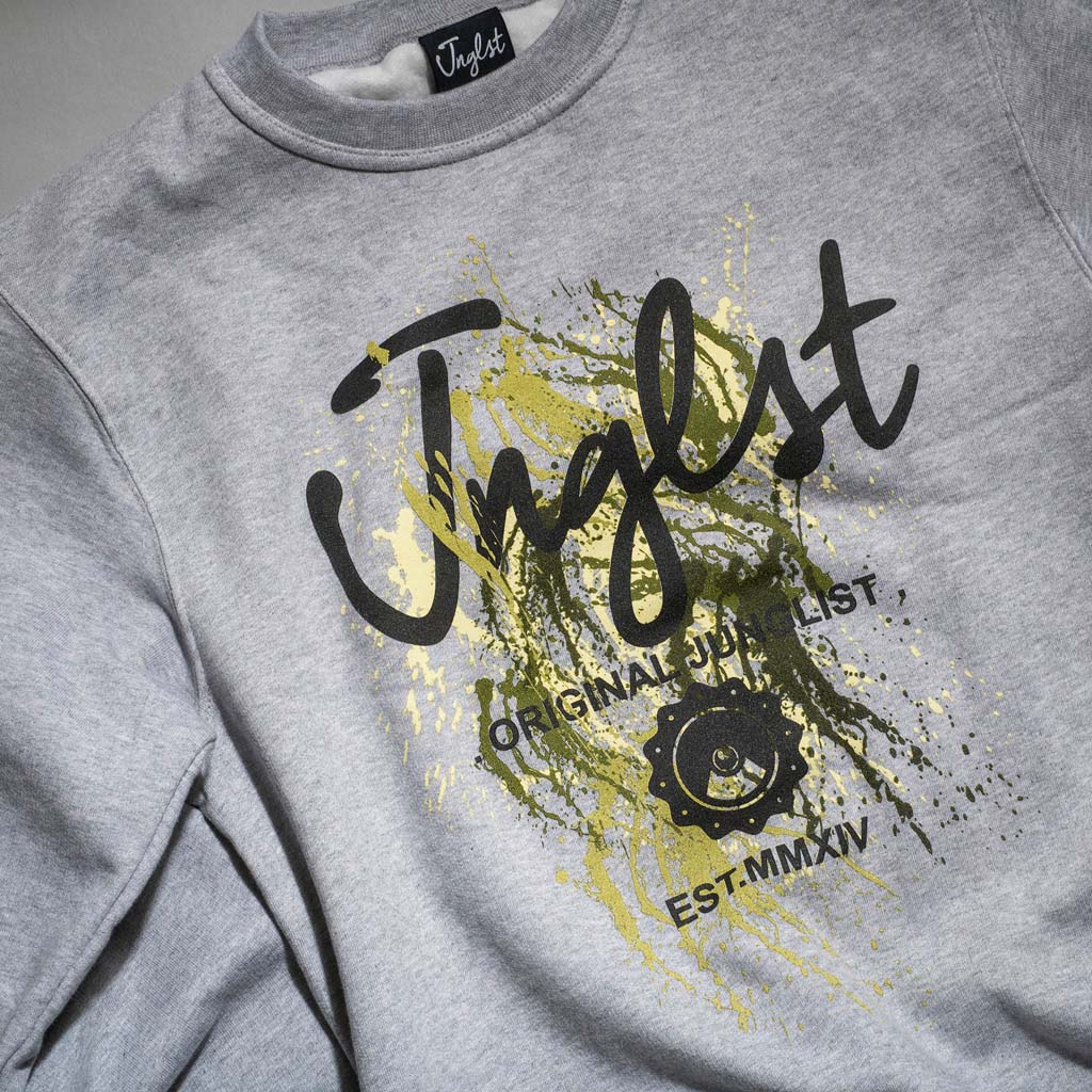 Close up of Paint Splatter Jnglst Clothing Sweat