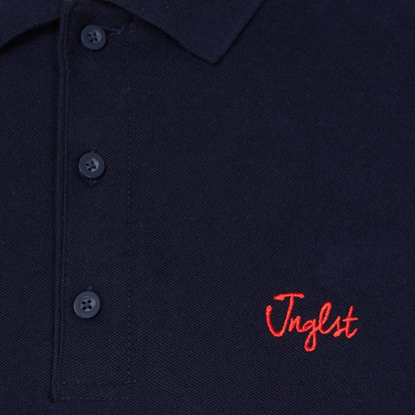 Navy Jnglst polo close up
