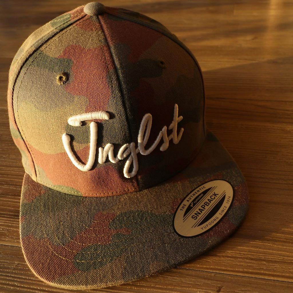 Woodland camo snapback by Jnglst Clothing