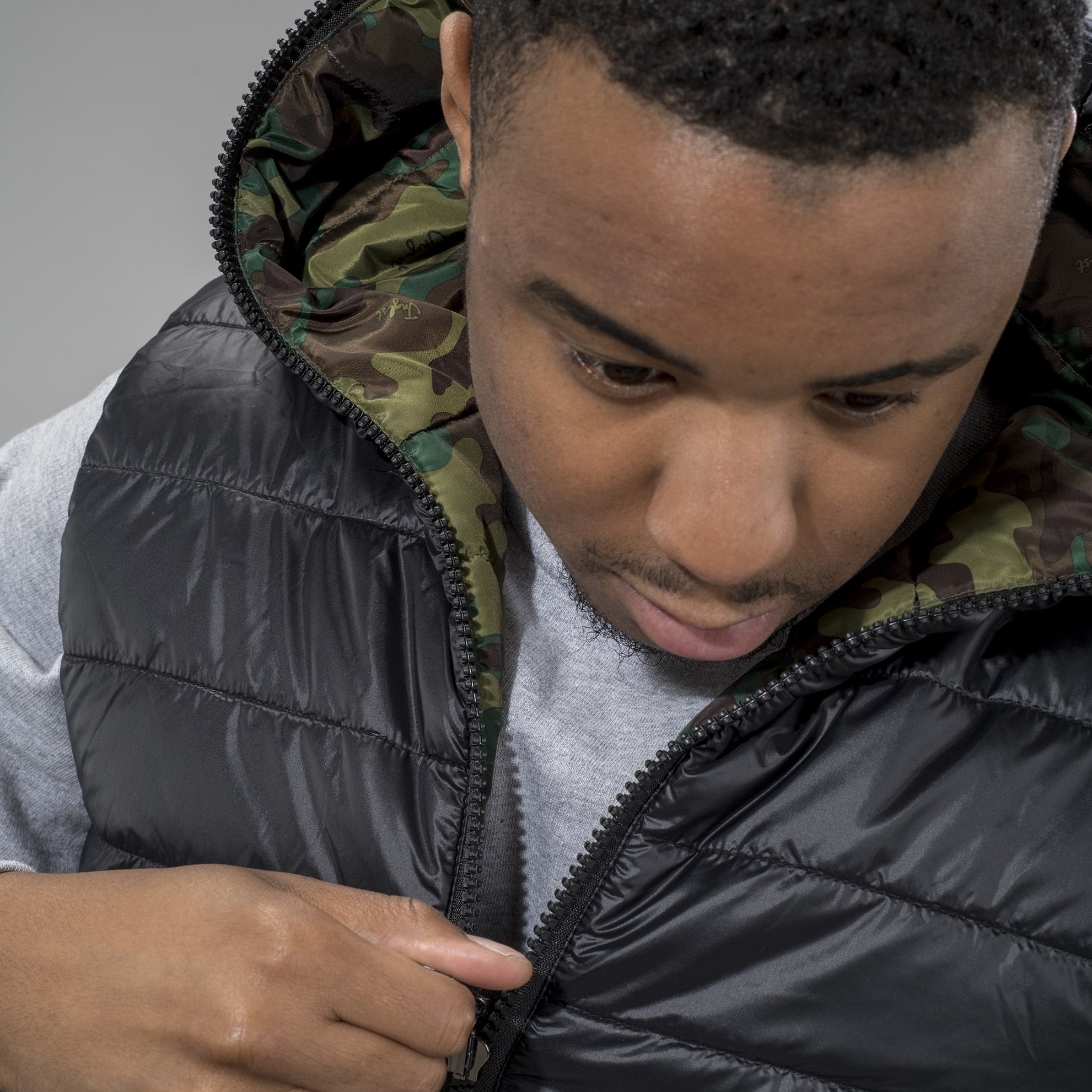 Model in Junglist Network's Camo Body Warmer