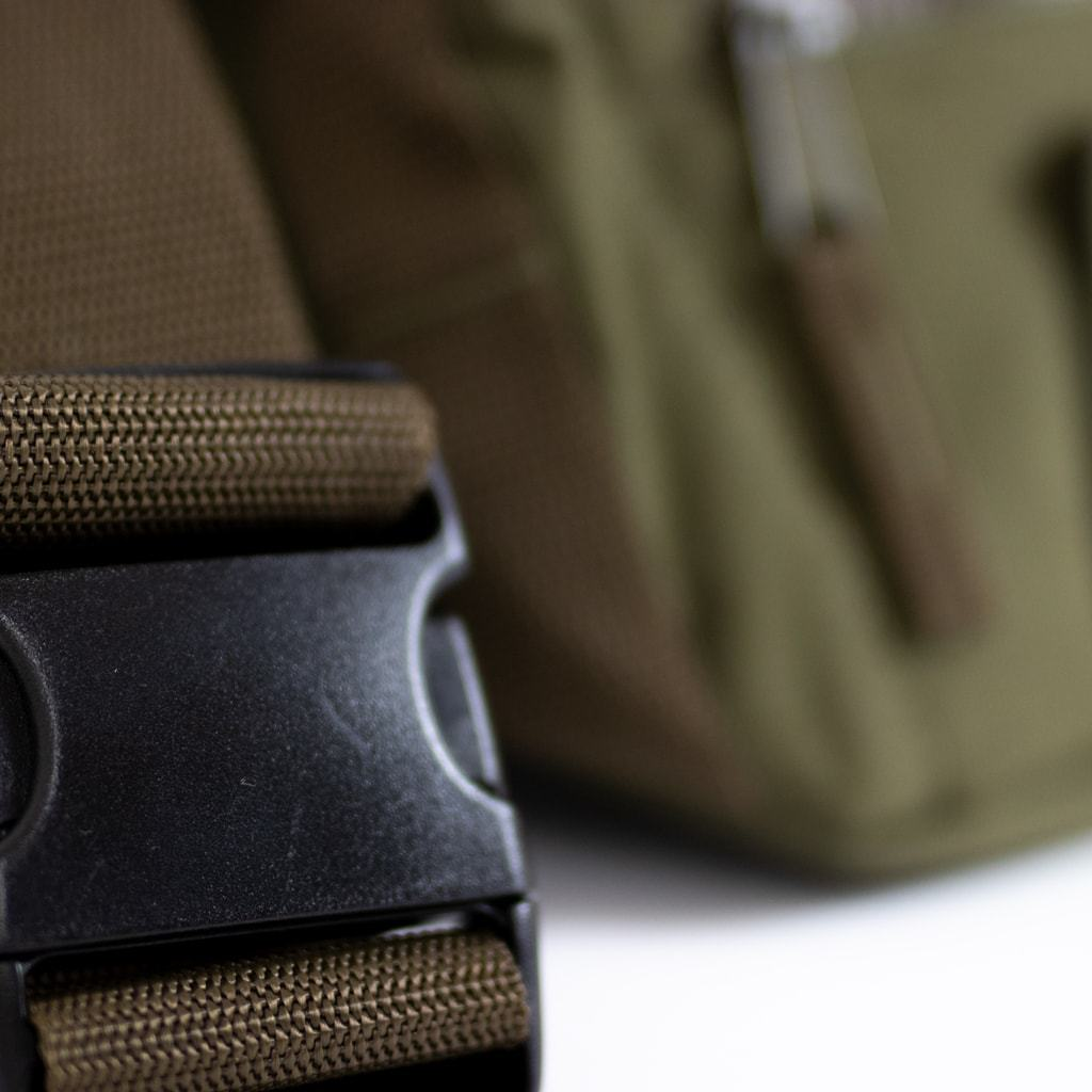 Strap of our Junglist Utility Raver Bag in Olive Green