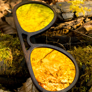 Jnglst Dark Bamboo Sunglasses with orange lenses