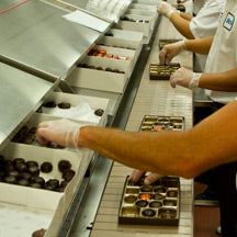 Factory workers packing chocolate boxes