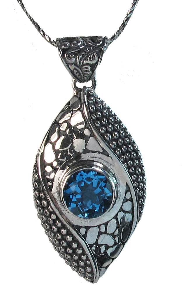 Blue topaz in dotted catseye - Agabhumi