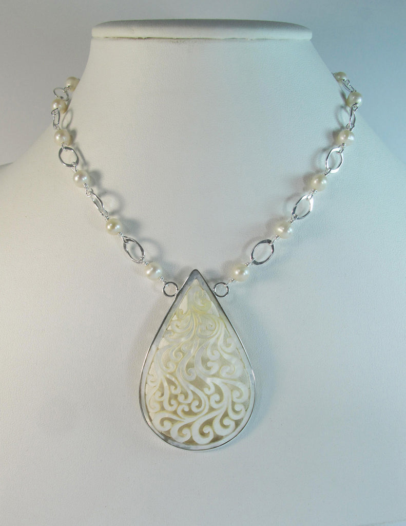 Carved mother of pearl shell teardrop with pearls
