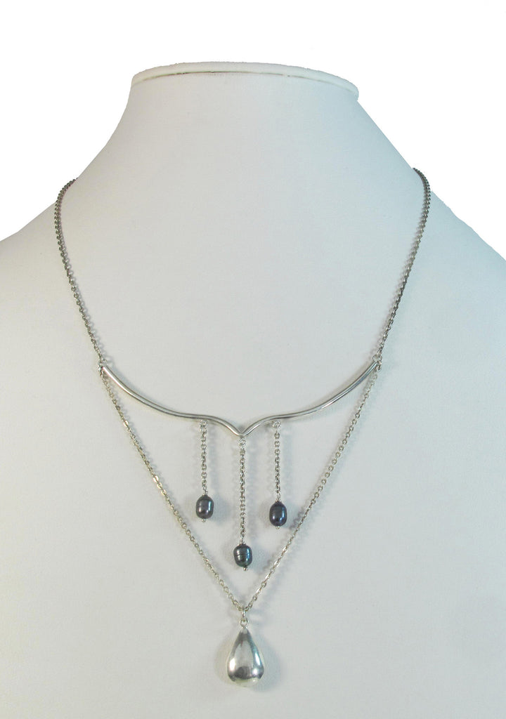 Trio of iridescent pearls on chains and 3D sterling silver drop on sterling chain necklace.