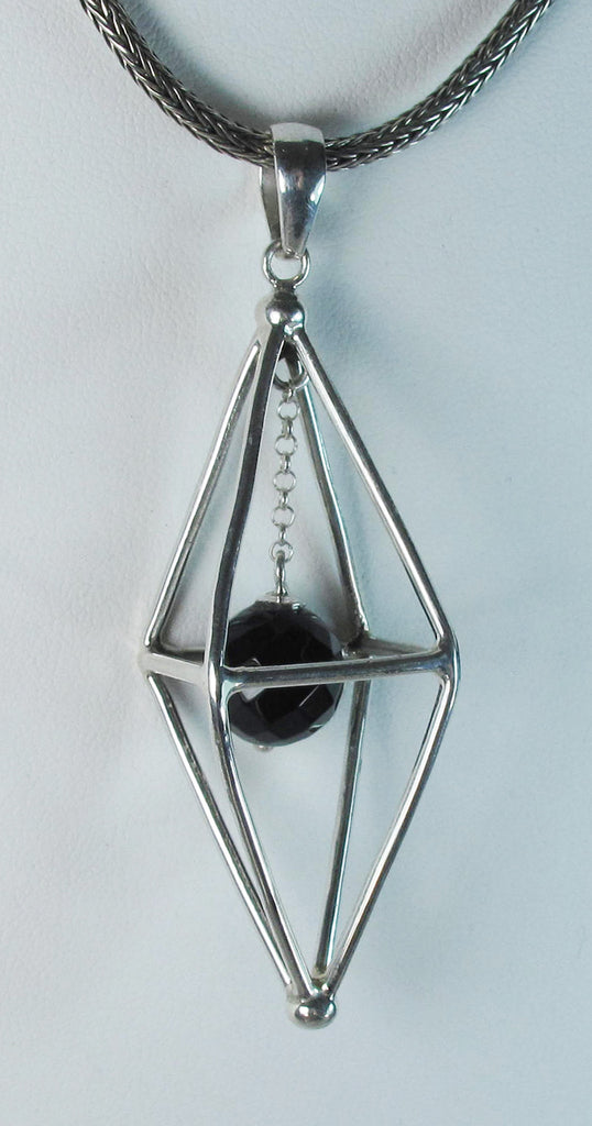 Caged pendulum with onyx