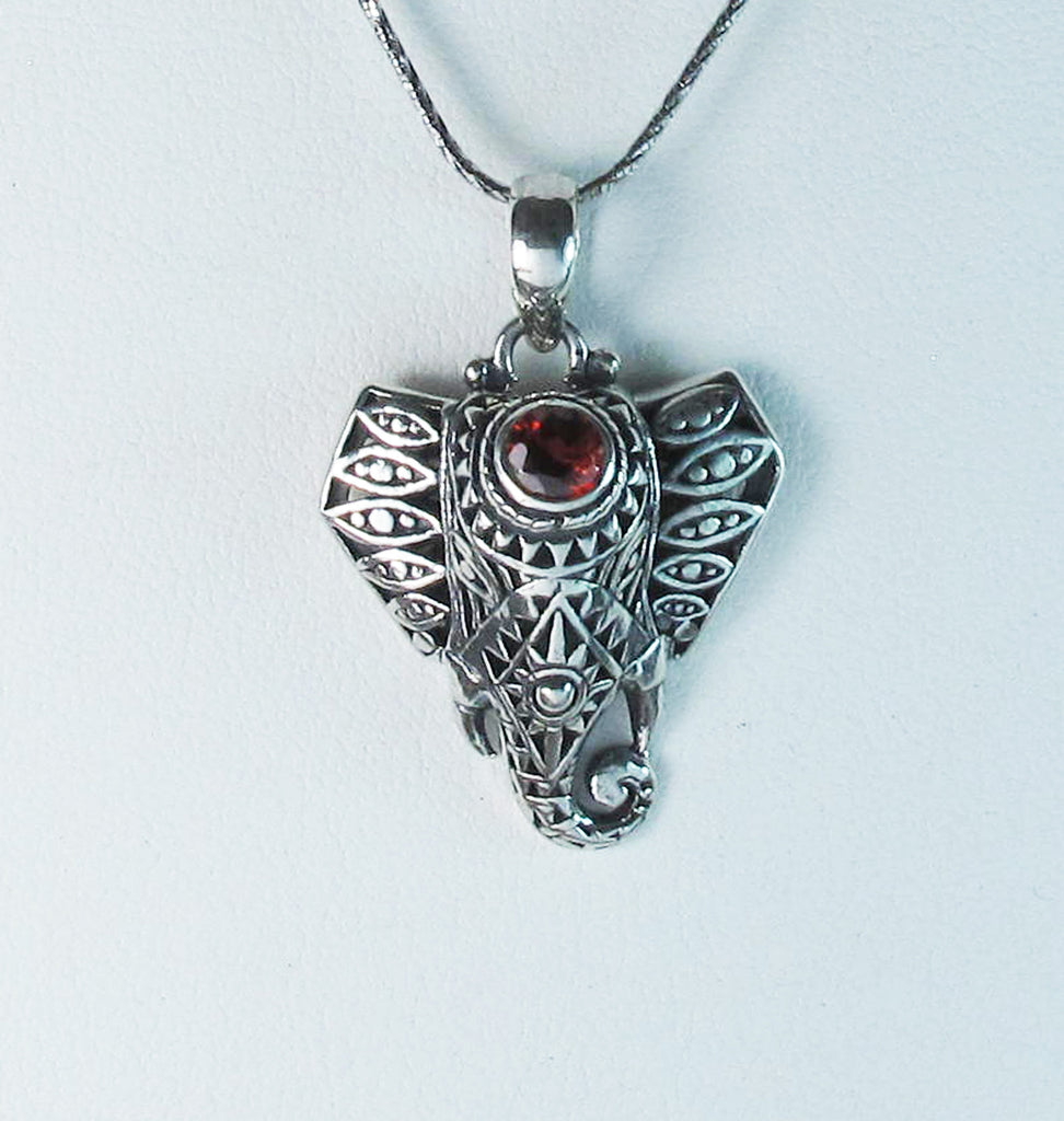 Bejeweled elephant with red quartz