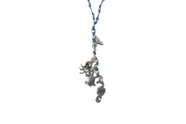 Sea creature charms on beaded cord - Agabhumi