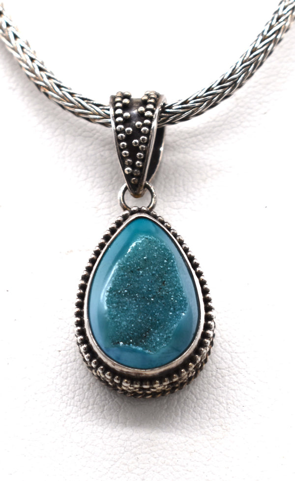 Druzy drop with ornate silver frame and bale