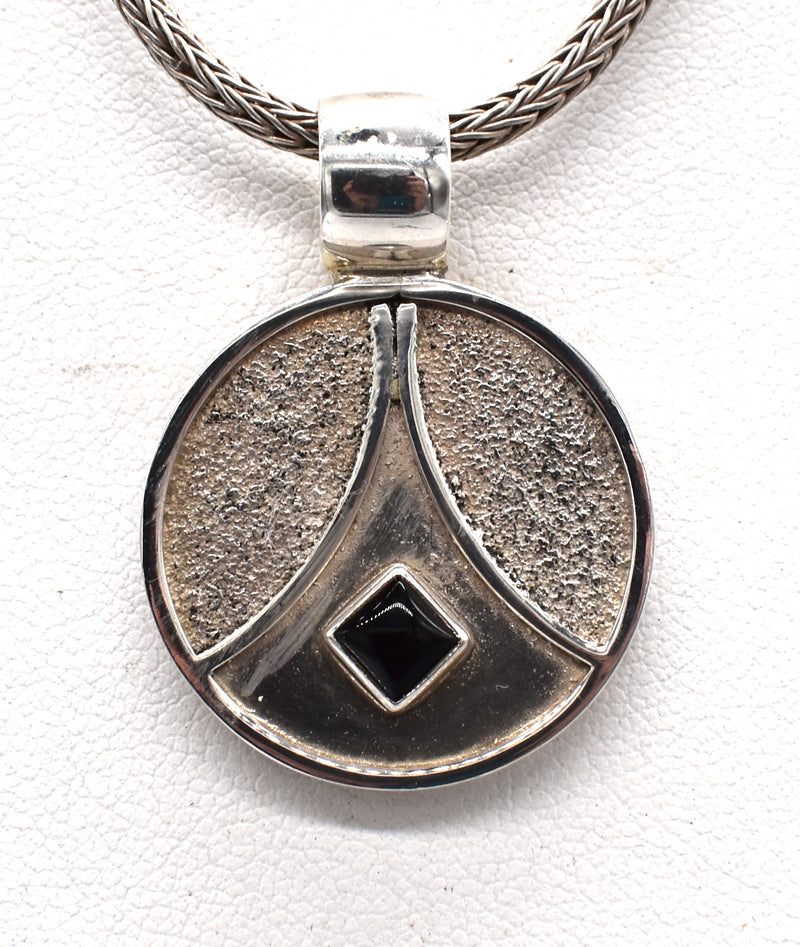 Starship onyx on galaxy pendant