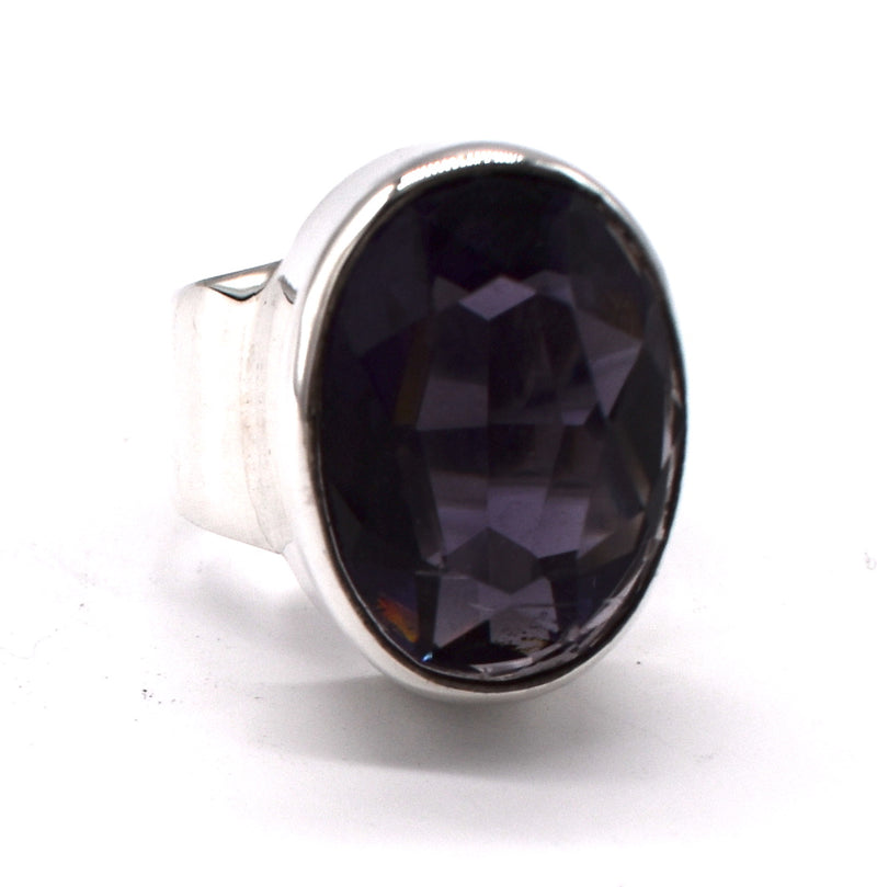 Faceted synthetic amethyst in smooth sterling