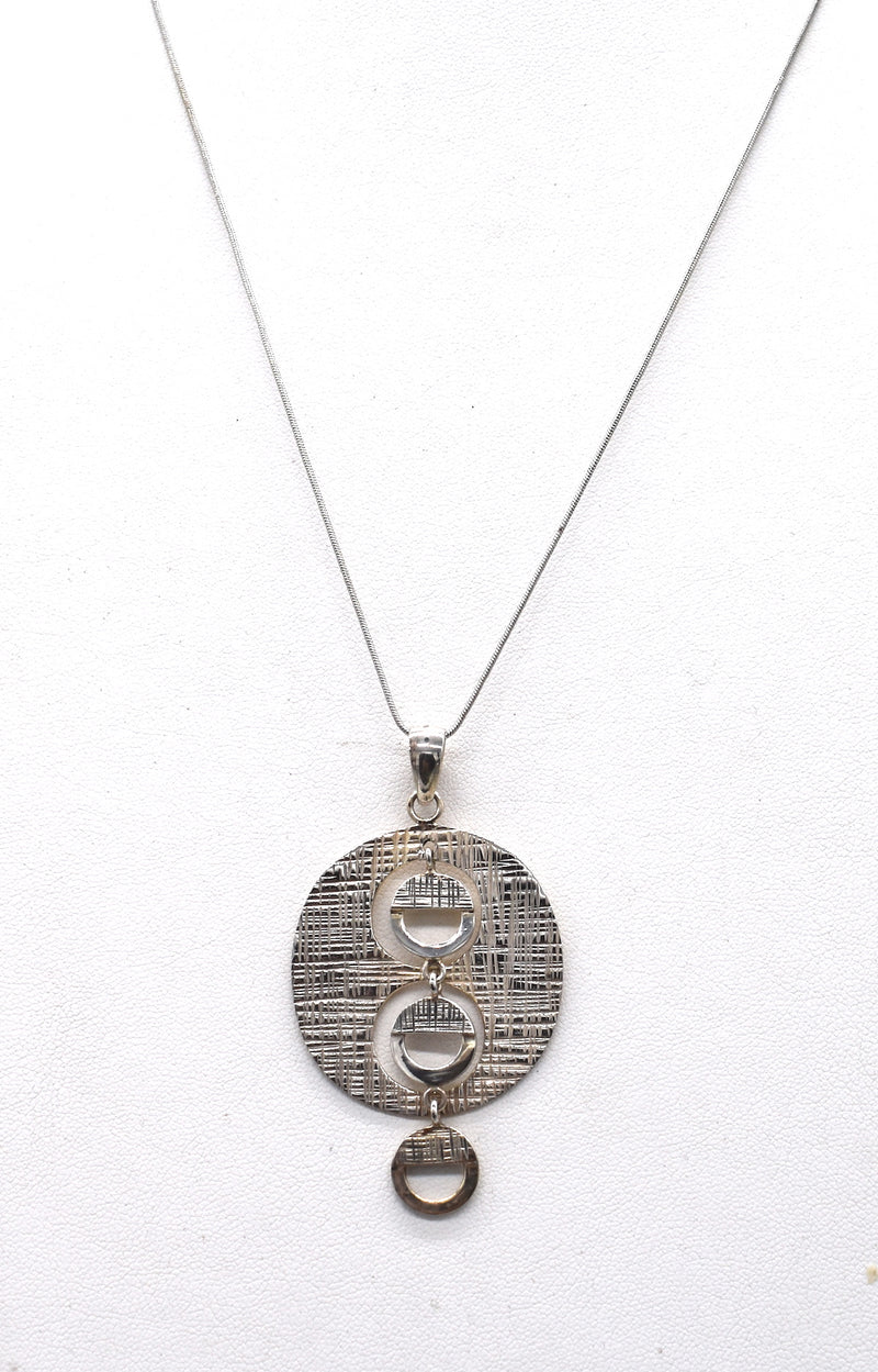 Kinetic sterling silver pendant