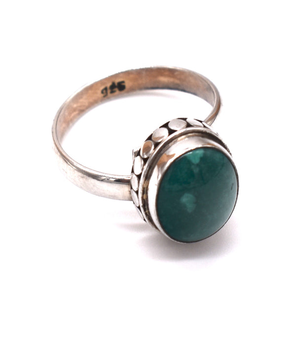 Turquoise oval in silver setting
