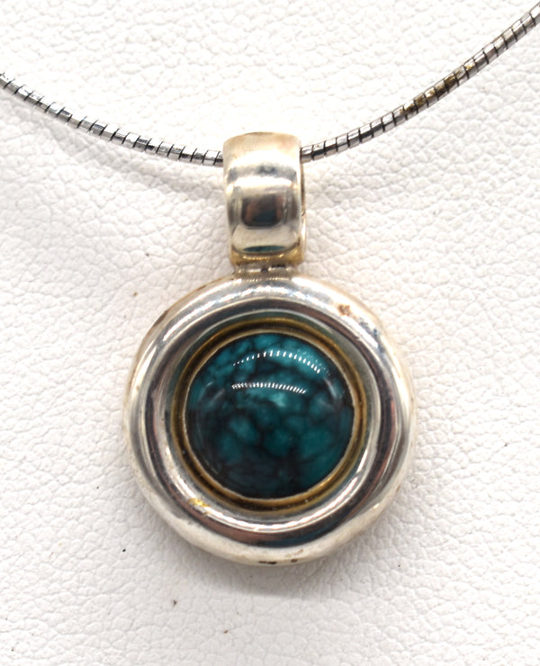 Turquoise circle in Silver frame