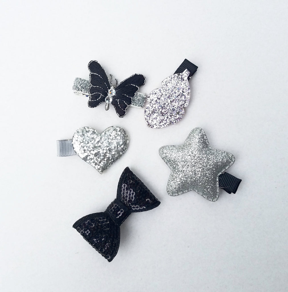 Heart, star, butterfly, and regular bow shaped; handmade with glitter colored in silver, black and grey