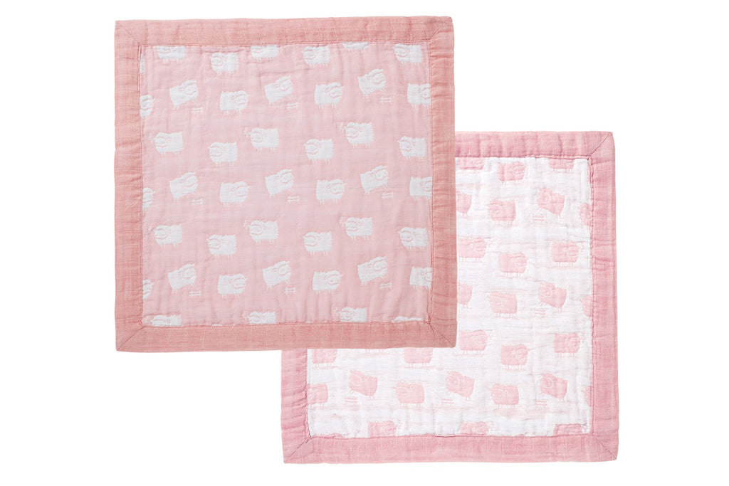 Pink security blanket with sheeps all over front and back with a satin border