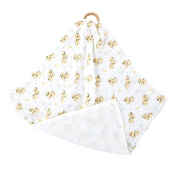 Unisex teething blanket with puppy designs all over the front of the blanket, back is plain white, really soft