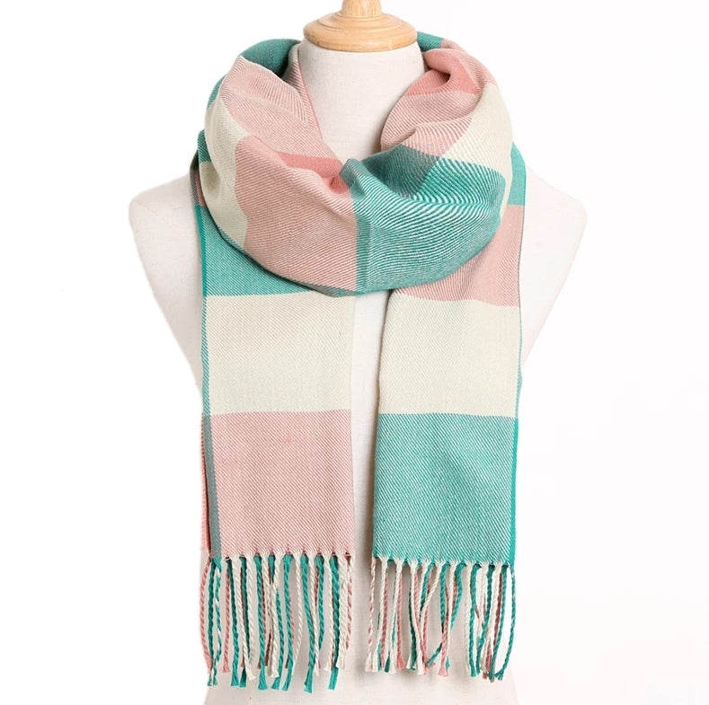 Color blocked infringed cashmere scarf in aqua and light pink, strings at the bottom